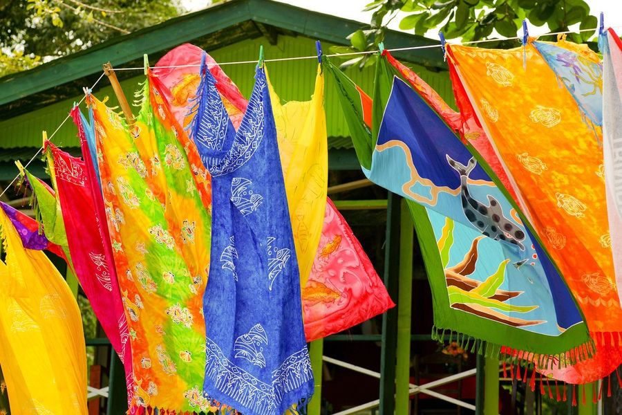 Colorful laundry on a wire Wire Tropical Laundry Towels Colorful Hanging Day Drying Multi Colored Text Outdoors For Sale No People Retail  Clothesline Market Variation