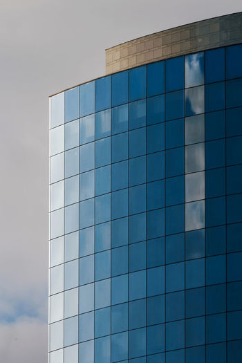 Architecture Built Structure Glass - Material Sky Building Exterior Reflection Office Building Exterior Office Modern Building Blue Day No People City Low Angle View Nature Outdoors Pattern Cloud - Sky Shape Skyscraper