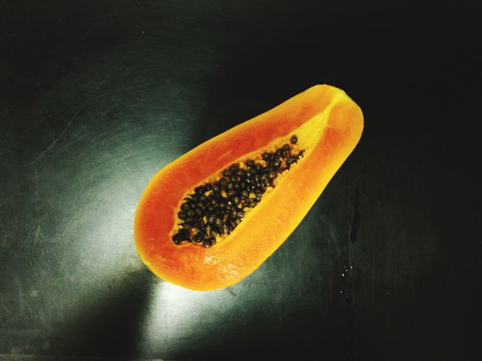 High angle view of orange on table against black background