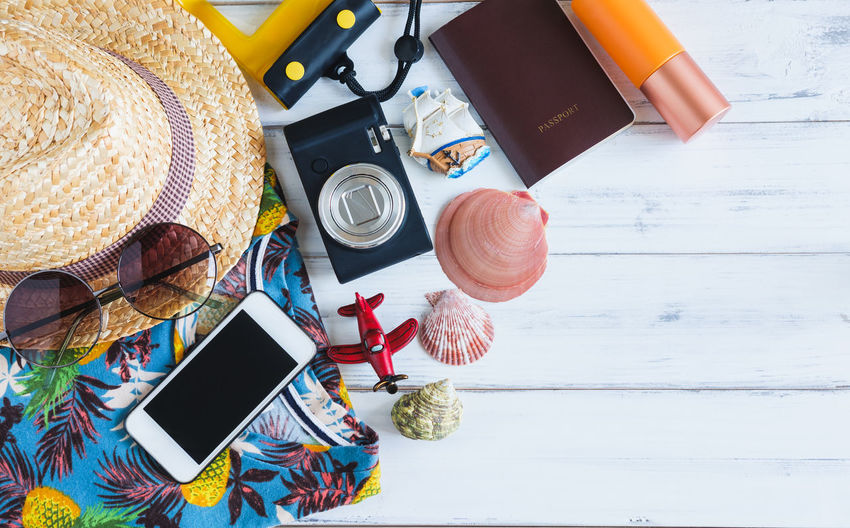 Holiday Travel Vacations Accessories Beach Concept Device Screen Digital Camera Directly Above Eyeglasses  Flat Lay High Angle View Journey Personal Accessory Photographic Equipment Photography Themes Portability Screen Still Life Stuff Summer Sun Hat Sunglasses