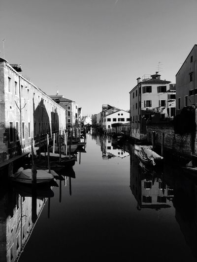 Building Exterior Reflection Architecture Water Built Structure Transportation Moored Mode Of Transport Canal Waterfront Nautical Vessel Clear Sky Outdoors City Sky Day Venice No People