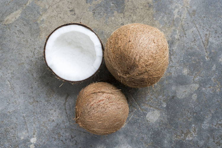 Coconut was piled on a concrete for coconut milk Coconut Cut Diet Nature Set Vegetarian Food Brown Coconut Coconut Oil Coconut Tree Coconutmilk Floor Food Fresh Fruit Half Health Healthy Organic Shell Spa Tasty Top View Tropical Vitamin