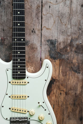 Close-up of guitar against wall