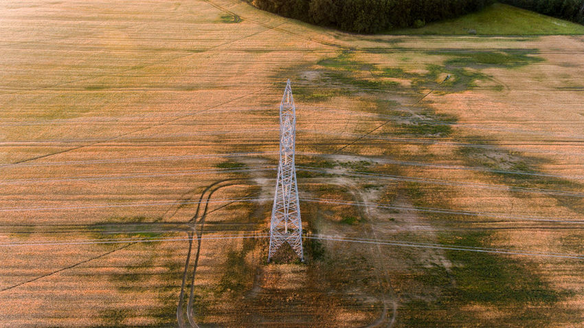 Drone  Sunlight Day Dronephotography Electrical Power Field High Angle View Land No People Outdoors Power Plug Scenics - Nature Utility Pole First Eyeem Photo