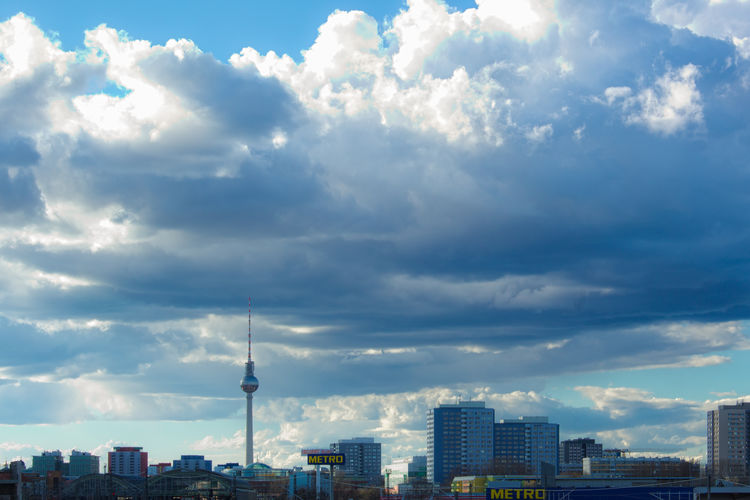 Overhanging. FILIPPI GIULIA PHOTOGRAPHY. Above Architecture Berlin Blue Building Exterior Canon City Cityscape Cloud - Sky Colors Day Germany High Metro Outdoors Photographer Photography Shade Skyscraper Street Streetphotography Tall Tower TV Tower Urban Skyline