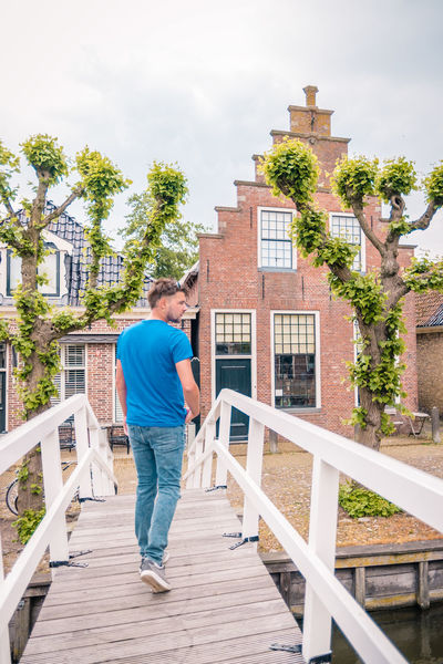 Netherlands Adult Architecture Building Building Exterior Built Structure Casual Clothing Couple - Relationship Dutch Freisland Friesland Town Full Length House Leisure Activity Lifestyles Males  Men Outdoors People Railing Real People Sloterdijk Standing Steps And Staircases Town Two People Young Adult