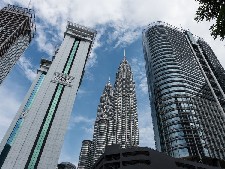 Petronas Towers and Blue Sky Architecture ASIA Building Exterior Buildings Business Finance And Industry City Cityscape Cloud - Sky Day Downtown District Kuala Lumpur Low Angle View Malaysia Modern No People Office Building Exterior Outdoors Petronas Petronas Twin Towers Sky Skyscraper Tower Towers Urban Skyline