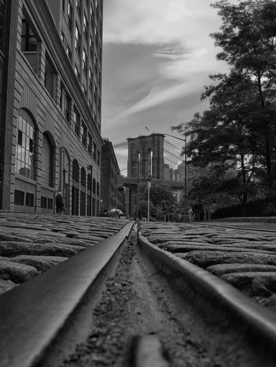 Railroad track against buildings in city