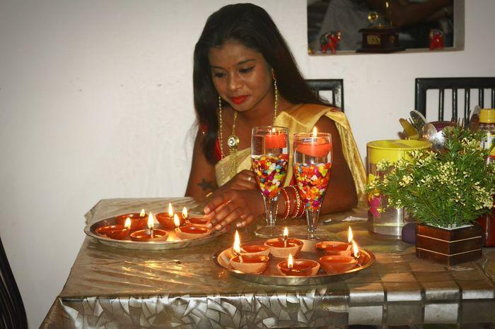 Eyemphotography EyeEm Selects EyeEmNewHere Eyemgallery Indian Culture  Adivasi Heartbeat Moments Light And Shadow EyeEmlights Indoors  People Candle Bangle Sitting Young Women Day Flame