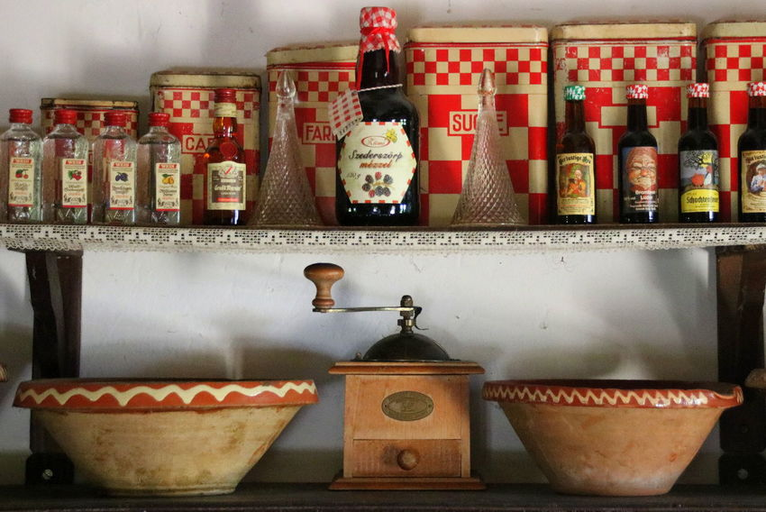 Antique Arrangement Bottle Choice Close-up Coffee Mill Collection Day Food Freshness Indoors  Iron Box Large Group Of Objects Multi Colored No People Old Boxes Old Kitchen Retail  Shelf Variation