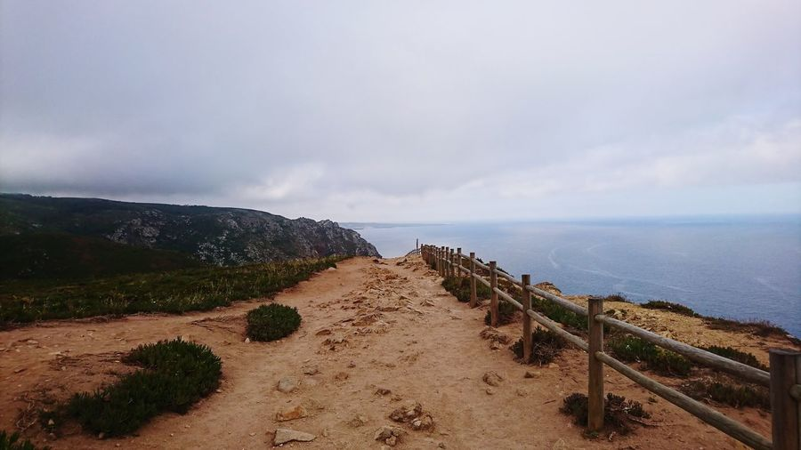 Portugal Cabo Da Roca Most Western Point In Europe Ocean Roacks Rocky Mountains Blue Water Sea Beach Sand Sky Horizon Over Water Landscape Cloud - Sky Countryside