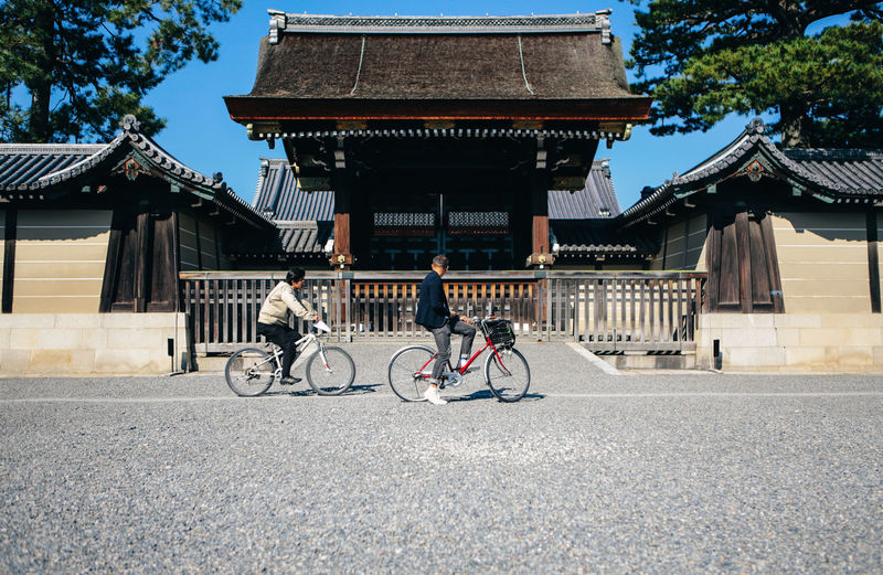 Cyclists in front of the Imperial Palace in Kyoto, Japan. Bicycle Bike Castle Commute Cyclist Cyclists Day Daylight Gate Imperial Palace Imperial Palace, Japan Japan Japanese  Japanese Culture Kyoto Men Palace Ride Stopover Sunny Tourist Tourist Attraction  Tourist Destination Travel The Traveler - 2018 EyeEm Awards