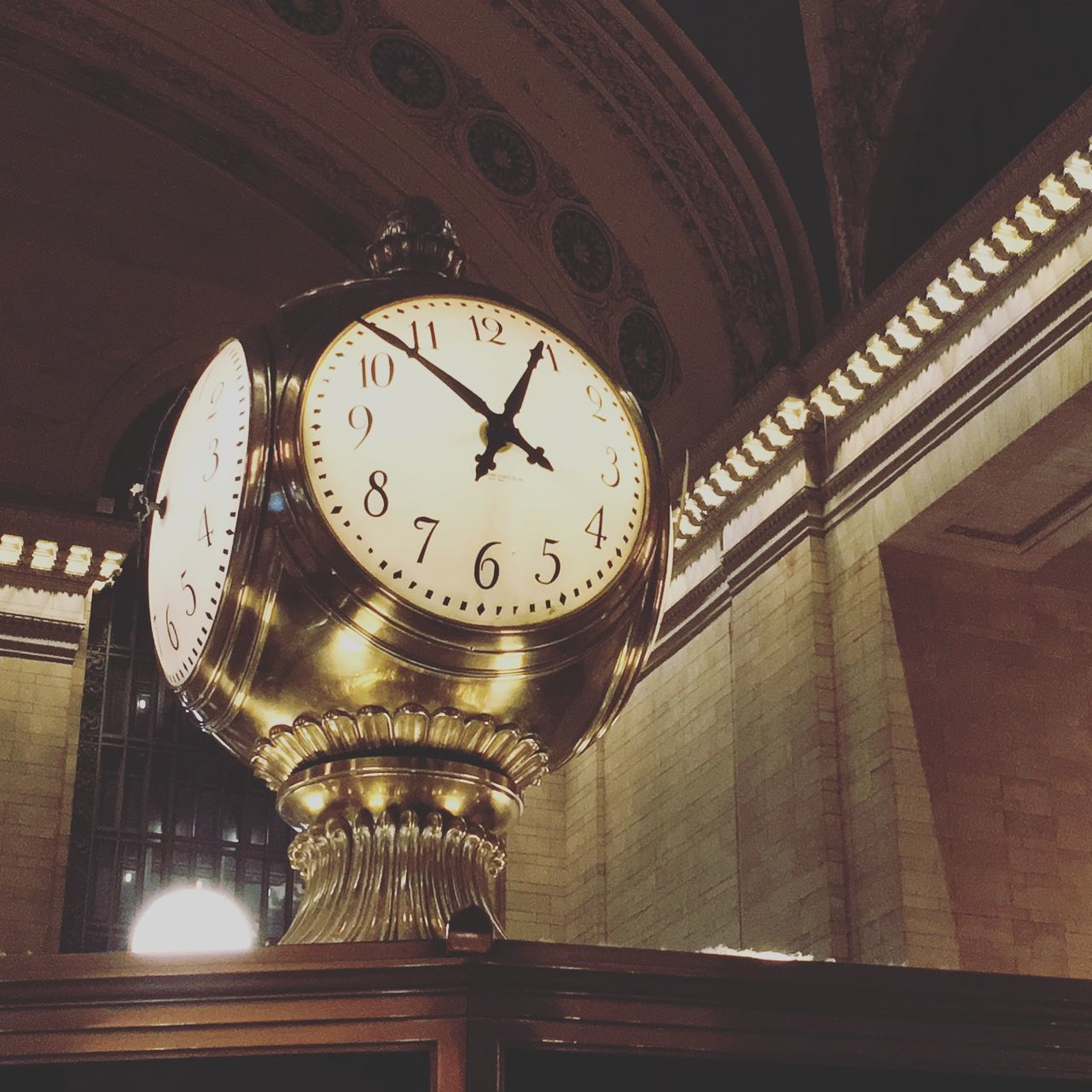 clock, time, low angle view, illuminated, indoors, architecture, built structure, no people, instrument of time, ceiling, lighting equipment, circle, clock face, minute hand, hanging, number, shape, geometric shape, technology, railroad station, architectural column, wall clock