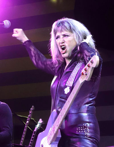 The awesome Suzi Quatro performing live to a huge audience on the MV Magellan cruise ship - Rock the Boat UK 2017 cruise 1960's Rock Group Base Guitar Devil Gate Drive Live On Stage Music Rock The Boat UK 2017 Suzi Quatro Adult Arts Culture And Entertainment Awsome Performance Guitar Human Body Part Human Hand Indoors  Leather Clothes Leisure Activity Lifestyles Microphone Mouth Open Music Musical Instrument Musician Night One Person People Performance Playing Real People Rock Legend Rock Music Screaming Shouting Singer  Singing Stage Lighting Young Adult Young Women