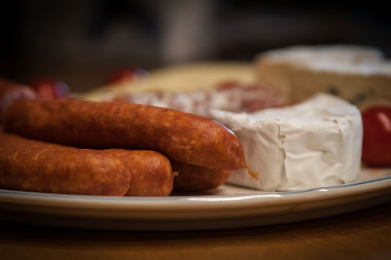 Close-Up Of Sausages Served In Plate On Table