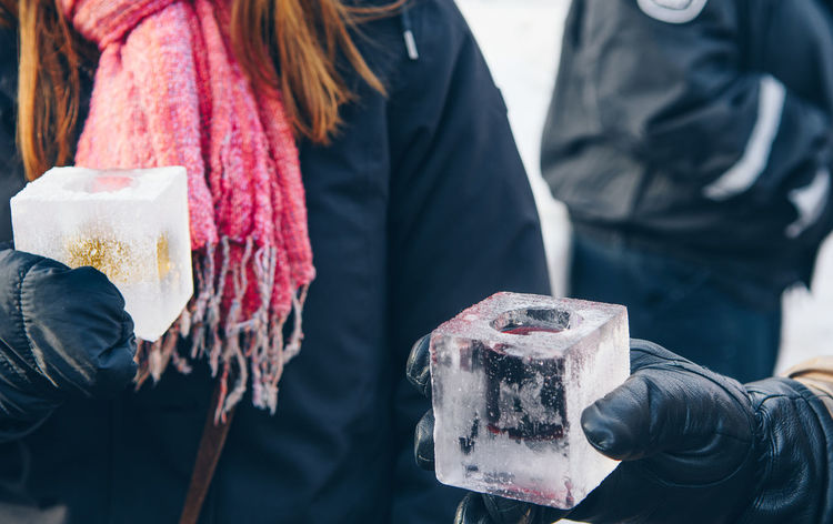 Enjoying whiskey in ice cube cup Ice Cup Ice Cube Winter Alcoholic Drink Cheers Close-up Day Focus On Foreground Food Food And Drink Freshness Holding Human Hand Ice Shots Lifestyles Men Midsection Occupation Outdoors People Real People Whiskey