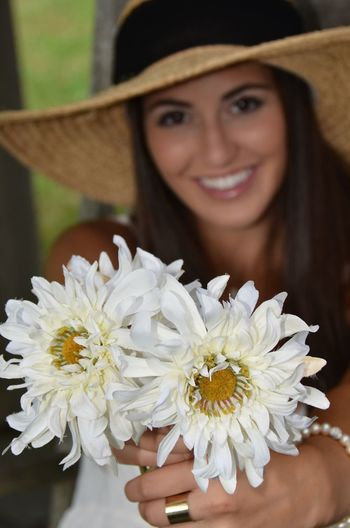 Portrait of beautiful young woman with white flowers