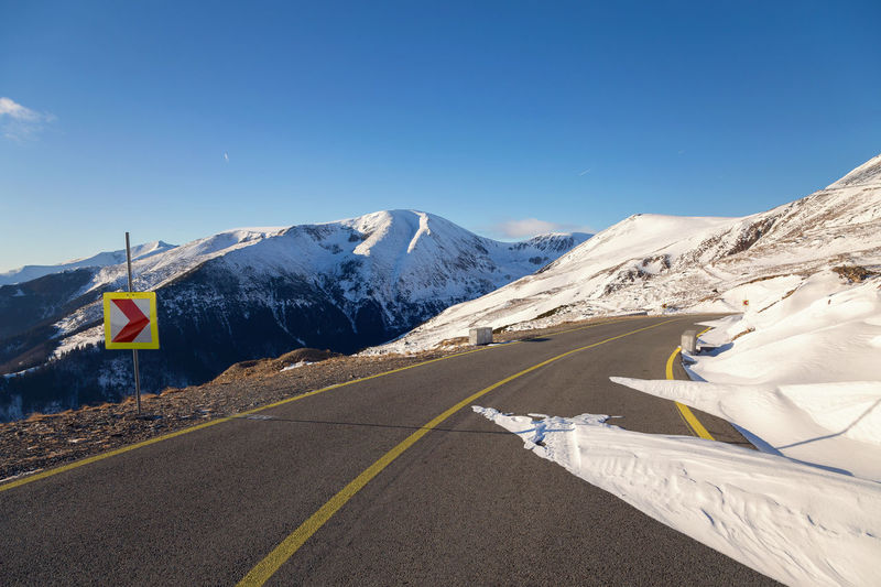 Mountain road blocked by snow Carpathians Clear Sky Day Landscape Mountain Mountain Range Nature Outdoors Road Blocked Scenics Snow Transalpina Road Travel Destinations