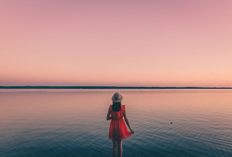 Magic moments Adult Adults Only Beach Beauty In Nature Clear Sky Horizon Over Water Nature One Person One Woman Only One Young Woman Only Only Women Outdoors People Photography Themes Red Reflection Scenics Sea Sky Standing Sunset Tranquil Scene Tranquility Water Young Adult Fresh On Market 2017