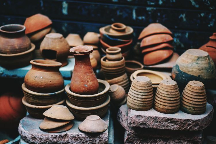 Close-up of clay containers at market stall