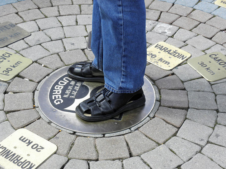 Center Of The World Centrum Mundi Eu Europe Holy Sunday Ludbreg,Croatia Casual Clothing City Square Close-up Day Destination Distance Geography Human Leg Jeans Km Lenght One Person Outdoors People Real People Shoe Standing Summer Tourist Destination