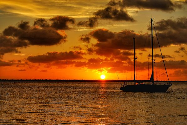 Sunset Horizon Over Water Horizon Clouds And Sky Clouds Ocean Ocean View Caribbean Sea Caribbean Caribe EyeEm Selects Sunset Sea Nautical Vessel Sky Beauty In Nature Nature Scenics Orange Color Cloud - Sky Water Transportation Sun Dramatic Sky Tranquility Mast Silhouette Mode Of Transport Tranquil Scene Sailboat No People