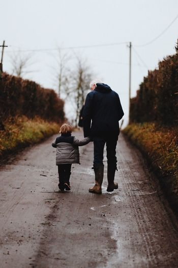 Walking Rear View Full Length Togetherness Family With One Child Bonding The Way Forward Childhood People Warm Clothing Women Men Real People Day Father Adult Sky Outdoors