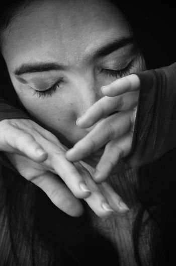 High Angle Close-Up Of Woman With Closed Eyes Covering Face