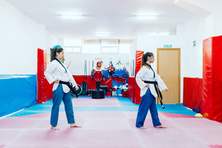 Young women practicing martial arts
