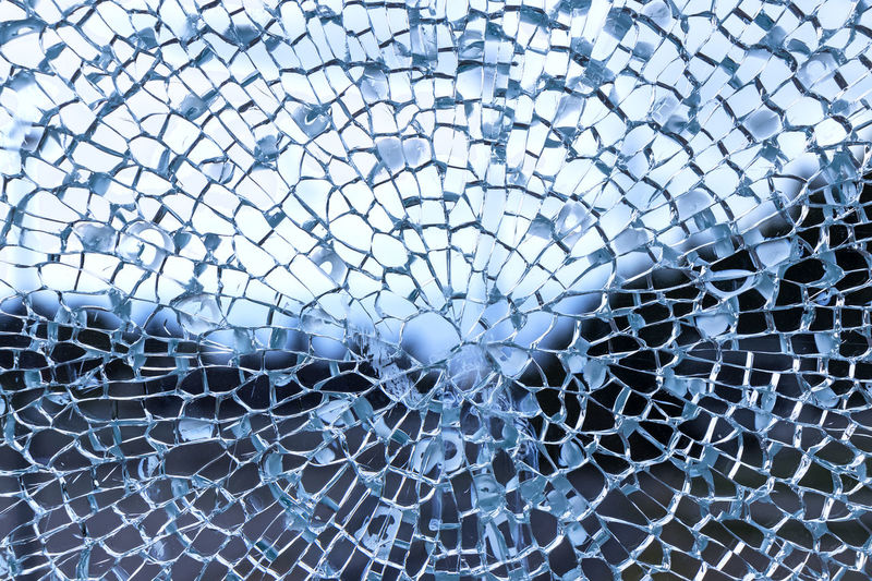 Cracked glass pane Pattern Broken Backgrounds Full Frame No People Close-up Fragility Shattered Glass Vulnerability  Cracked Glass - Material Damaged Misfortune Textured  Window Destruction Abstract Focus On Foreground Day Complexity Breaking
