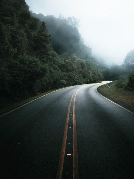 One of the empty foggy roads high in the jungle mountains of Costa Rica. Costa Rica Foggy Weather Freedom Moody Sky Road Transportation Way Home Dark Road Empty Road Far Way Fog Foggy Day Foggy Road Free Road Jungle Moody Nature Moody Road Moody Weather No People Road Marking Roadside The Way Forward Tranquil Scene Tranquility Way