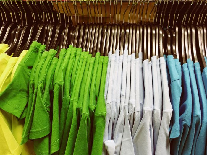 Close-up of multi colored t-shirts for sale