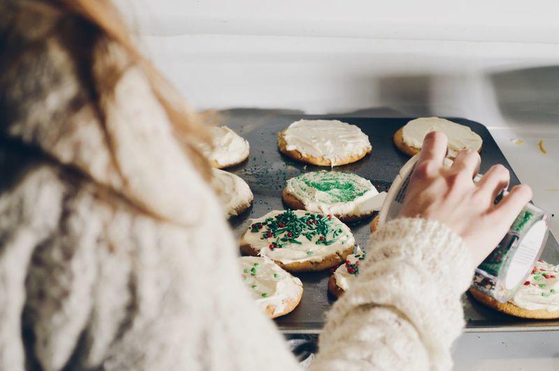 Close-Up Of Woman Preparing Food At Home