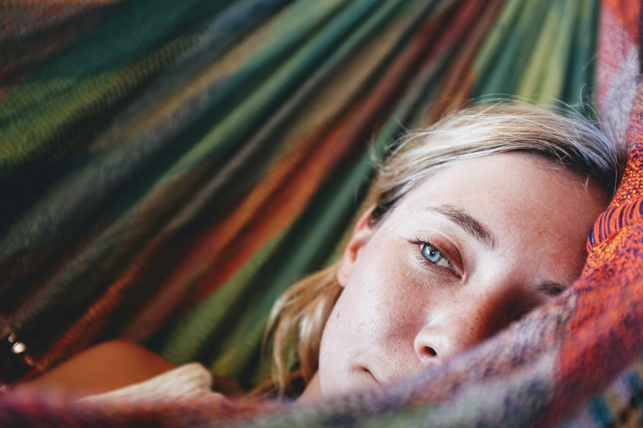 Close-Up Of Young Woman Lying On Hammock