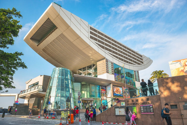 Architecture Built Structure Building Exterior Sky City Cloud - Sky Nature Day Incidental People Modern Building Street Tree Art And Craft Outdoors People Group Of People City Life Men Women Office Building Exterior