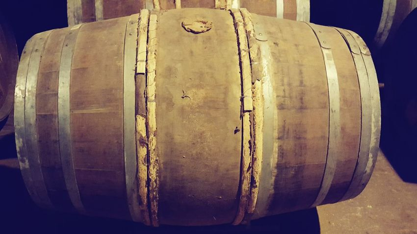 Indoors  Business Finance And Industry No People Close-up Wine Cask Day Drink Travel Destinations Cognac Region Ville De Cognac Cognac Barrels Of Cognac Basement Alcohol Winemaking Barrel Warehouse Food And Drink Industry Large Group Of Objects In A Row Barrels