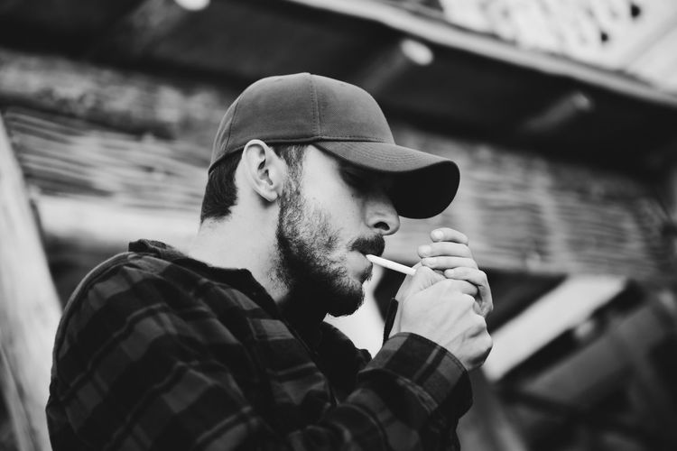 Bad Habit Beard Cigarette  Clothing Focus On Foreground Hat Headshot Leisure Activity Lifestyles Mature Men Men Mid Adult Mid Adult Men One Person Portrait Real People Smoking Issues Social Issues
