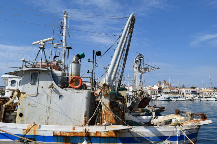 Fishing boat in the port of Aigina Blue Boat Cloud Cloud - Sky Commercial Dock Day Development Fishing Boat Harbor Mast Nature Nautical Vessel No People Outdoors Sailboat Ship Sky Transportation Water