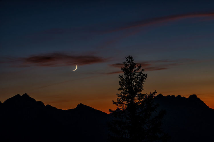 After sunset Dark Dusk Night Non-urban Scene Outdoors Idyllic Orange Color No People Moon Mountain Nature Cloud - Sky Plant Tree Tranquil Scene Tranquility Scenics - Nature Beauty In Nature Silhouette Sky Sunset Austria Tyrol Alps Astronomy Space