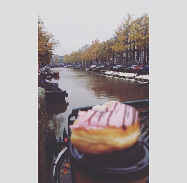 Amsterdam Donuts🍩 Donut One Person Real People Human Body Part Human Hand Tree Transportation Leisure Activity Water Lifestyles Day Photography Themes Outdoors People Adult One Man Only Men Adults Only Sky Only Men First Eyeem Photo