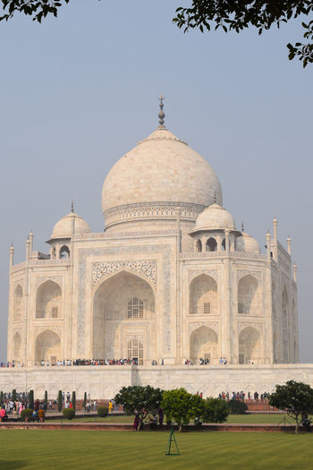 Low angle view of taj mahal against clear sky on sunny day