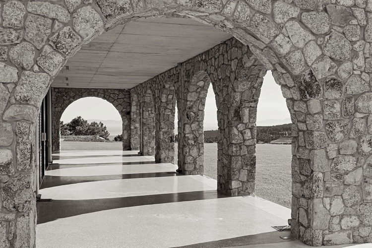 Stone archways make an interesting scene on hillside building in South Africa. Architecture B&W Collection Black & White Patio Stone Arches Arch Arch Way Arches And Columns Architectural Column B&w Photo Balcony Black And White Building Exterior Built Structure Concrete Floor Indoors  No People Round Shape Stone Tile Stone Wall Stonemason Art Stones Stonework Sunlight