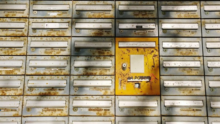 Full frame shot of rusty mailboxes
