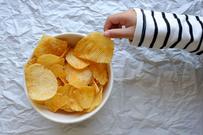 Carbohydrate - Food Type Choose Close-up Crispy Day Food Food And Drink Freshness Fried Healthy Eating Human Body Part Human Hand Indoors  One Person People Picking Potato Chip Snack