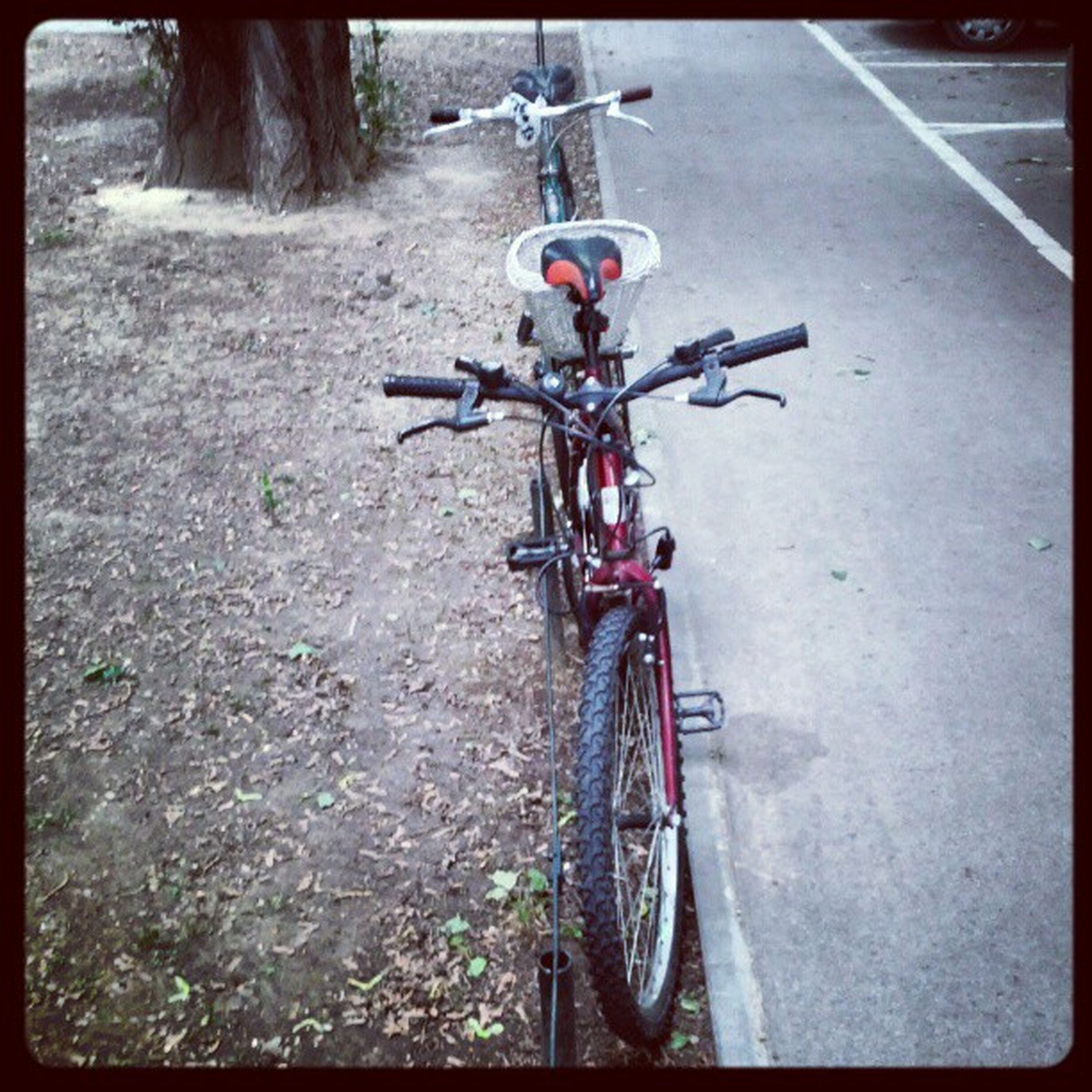 transportation, bicycle, mode of transport, land vehicle, stationary, parked, parking, street, road, wheel, travel, motorcycle, asphalt, tire, auto post production filter, outdoors, high angle view, day, cycling, riding