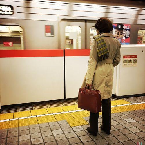 Woman Standing At Subway Station Platform