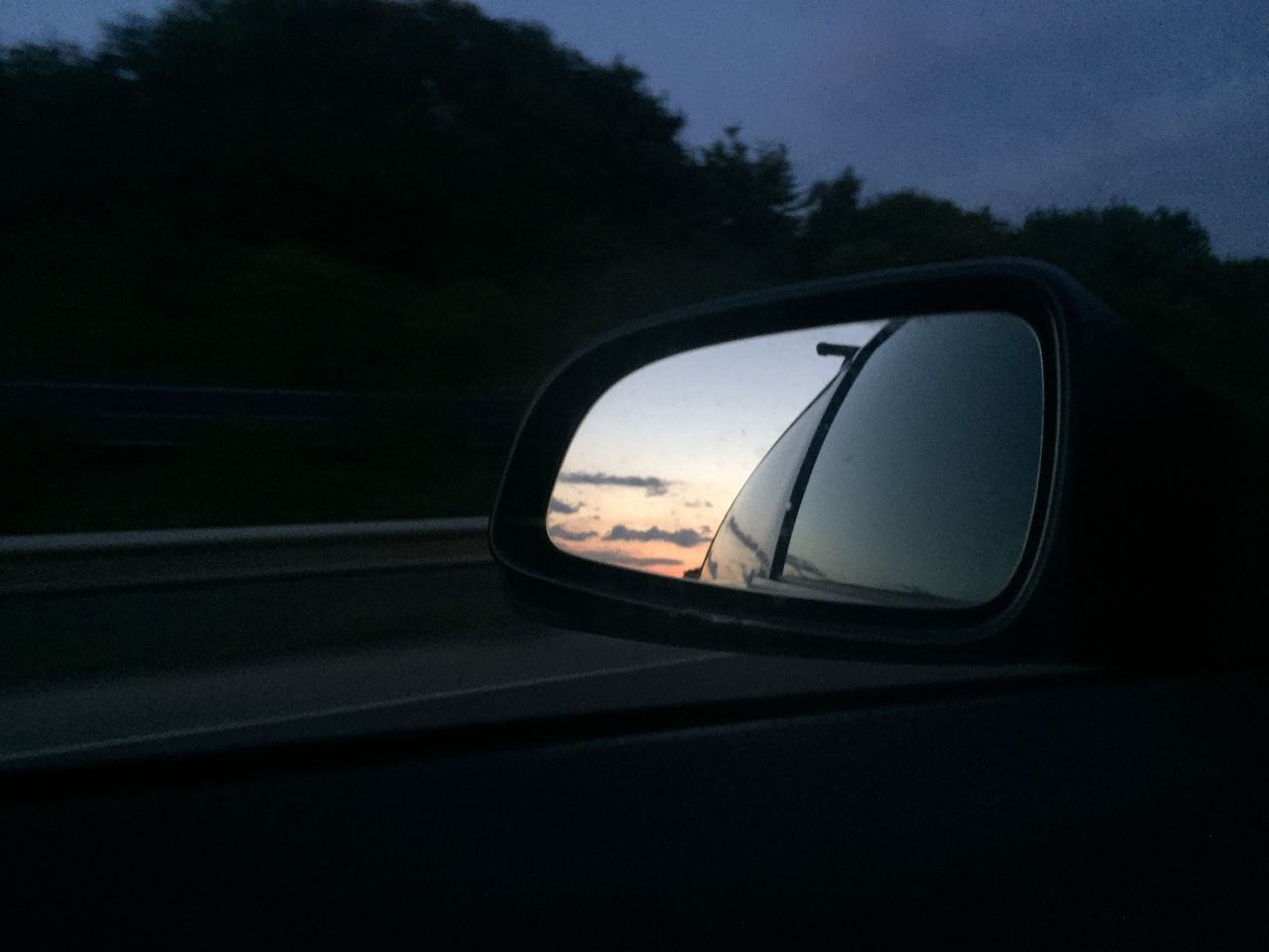REFLECTION OF CAR ON SIDE-VIEW MIRROR OF VEHICLE