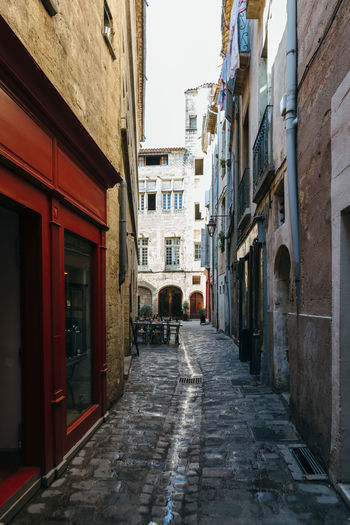 Streets of Pezenas, France Ancient Antique Narrow Paved Alley Architecture Building Building Exterior Built Structure City Day Direction Door Entrance Footpath House Medieval Narrow Old Outdoors Street Window