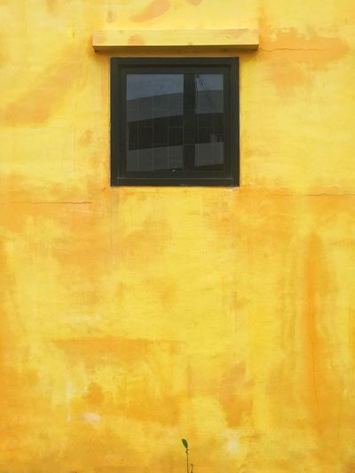 Yellow building against sky