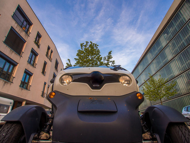 Adapted To The City Architecture Beginnings Car Day E-car Eco Tourism Freiburg Green City Land Vehicle No People Outdoors Parking Garage Sky Transportation Vauban Vehicle Mirror